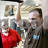 Rob Winner – rwinner@daily-chronicle.com<br /> <br /> Personal trainer Mike Sweeney (left) works with Dustin Marquis, a resident of DeKalb, at the Kishwaukee YMCA in DeKalb, Ill. on Tuesday June 22, 2010. Sweeney has been working with Marquis for about four weeks and they meet three to four times a week.