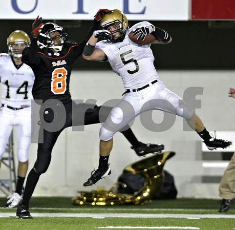 Beck Diefenbach – bdiefenbach@daily-chronicle.com<br /> <br /> Sycamore cornerback Eric Ray (5, right) intercepts the ball ahead of DeKalb wide receiver Javon Scruggs (8) during the second quarter of the Castle Challenge football game between DeKalb and Sycamore High Schools at Huskie Stadium on the campus of Northern Illinois University in DeKalb, Ill., on Friday Sept. 10 2010.