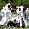 Rob Winner – rwinner@daily-chronicle.com<br /> <br /> The DeKalb Barbs celebrate their victory by mobbing Jake Gordon after his game winning hit for the IHSA Class 3A DeKalb Sectional semifinal on Wednesday June 2, 2010 in DeKalb, Ill.