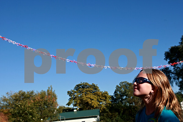 Beck Diefenbach – bdiefenbach@daily-chronicle.com<br /> <br /> West Elementary student Emmalee Torson inspects the daisy chain representing each lap ran by the girls during the Girls on the Run program at West Elementary School in Sycamore, Ill., on Tuesday Oct. 5, 2010.