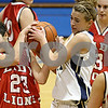 Rob Winner – rwinner@daily-chronicle.com<br /> LaMoille's Mary Bartoli (left) and Hiawatha's Sarah Schmidt battle for possession of a ball during the second half of their game at the Little 10 tournament in Hinckley, Ill. on Monday January 18, 2010.