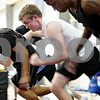 Rob Winner – rwinner@daily-chronicle.com<br /> Sycamore's Patrick Eby (left) and Scott Baker practice their starts from the blocks on Wednesday March 17, 2010 in Sycamore, Ill.