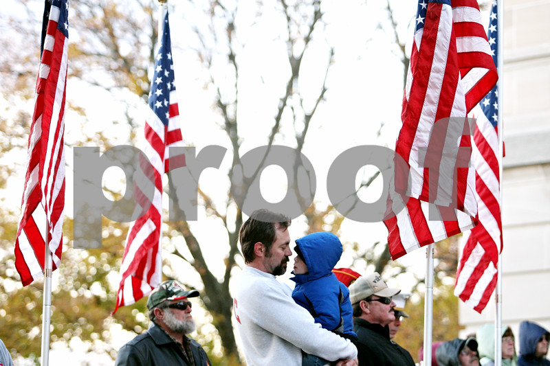Rob Winner – rwinner@daily-chronicle.com<br /> <br /> Sycamore resident Bob Hurley, a United States Marine Corps veteran, and his 4-year-old son, Connor, listen to a speech by state rep. Robert Pritchard, R-Hinckley, during the VietNow 25th annual 24-Hour Vigil in front of the DeKalb County Courthouse in Sycamore, Ill. on Friday November 5, 2010.