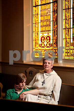 Beck Diefenbach  -  bdiefenbach@daily-chronicle.com<br /> <br /> Pastor Laura Crites (right) with her 17-year-old daughter Michelle at First Methodist Church in DeKalb, Ill., on Wednesday May 5, 2010.
