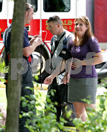 Beck Diefenbach  -  bdiefenbach@daily-chronicle.com<br /> <br /> Biology professor Linda Yates (name unconfirmed), right, has her blood pressure taken by firefighters following a fire in her lab on the fourth floor of the Montgomery Building on the campus of Northern Illinois University in DeKalb, Ill., on Thursday May 6, 2010.