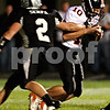 Beck Diefenbach – bdiefenbach@daily-chronicle.com<br /> <br /> DeKalb quarterback Brian Sisler (10, right) is sacked for a safety by Kaneland's Blake Serpa (2) during the first quarter of the game at Kaneland High School in Maple Park, Ill., on Friday Oct. 1, 2010.