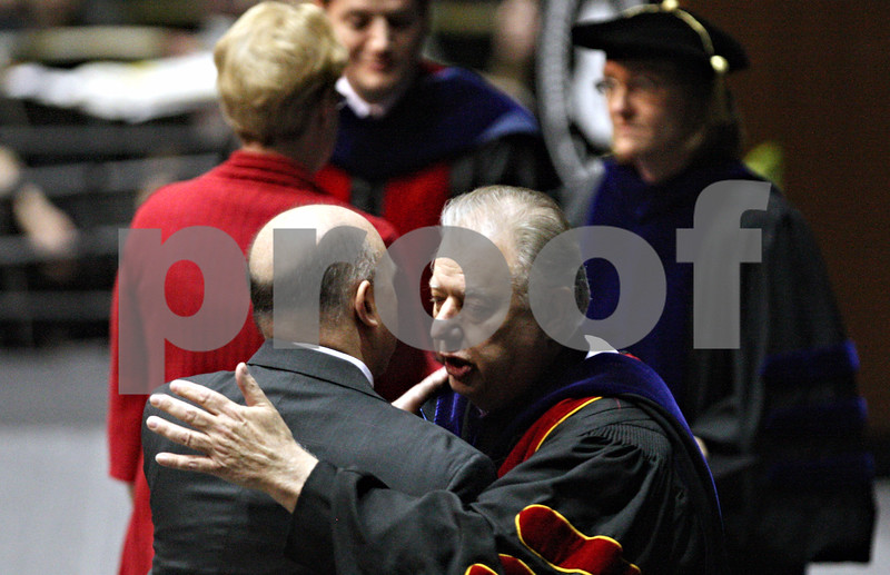 Rob Winner – rwinner@daily-chronicle.com<br /> <br /> President John Peters (right), of Northern Illinois University, hugs Gary Parmenter, the father of Daniel Parmenter, during the Saturday afternoon graduation ceremony on May 8, 2010.