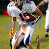 Beck Diefenbach – bdiefenbach@daily-chronicle.com<br /> <br /> Genoa-Kingston's Matthew Volkening (19) runs through the Hampshire defense during the first quarter of the game at Hampshire High School in Hampshire, Ill., on Friday Sept. 17, 2010.