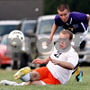 Beck Diefenbach - bdiefenbach@daily-chronicle.com<br /> <br /> DeKalb's Steven Murphy (21, bottom) keeps the ball in bounds during the first half of the game at DeKalb High School in DeKalb, Ill., on Tuesday Aug. 24, 2010. DeKalb and Hononegah tied 1 to 1.
