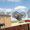 Beck Diefenbach  -  bdiefenbach@daily-chronicle.com<br /> <br /> DeKalb firefighter Mike Thomas tosses burned debris into a dumpster following a demonstration by the DeKalb Fire Department in support of residential sprinkler systems at DeKalb Taylor Municipal Airport in DeKalb, Ill., on Monday May 3, 2010. Another room equipped with a sprinkler system was also ignited and extinguished with its own sprinkler system.
