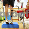 Beck Diefenbach  -  bdiefenbach@daily-chronicle.com<br /> <br /> Physical therapist Kristin Christian supports the knee of William Coffman of Kingston, during a session at the new Northern Rehab Physical Therapy Specialist location at 232 W. Lincoln Highway in DeKalb, Ill., on Monday August 2, 2010.