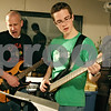 Rob Winner – rwinner@daily-chronicle.com<br /> <br /> Dave Young (left) works with David Hughes, of DeKalb, during band practice on Wednesday March 17, 2010 in the basement of Young's home in Cortland, Ill.