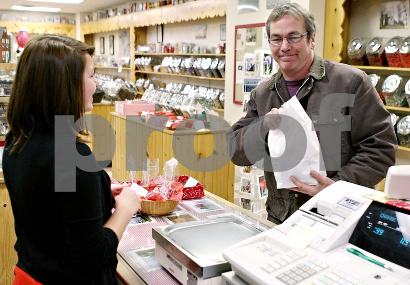 Rob Winner – rwinner@daily-chronicle.com<br /> <br /> Hampshire resident Robert Larson makes a holiday purchase at The Confectionary on Tuesday night in Sycamore for last minute shoppers.