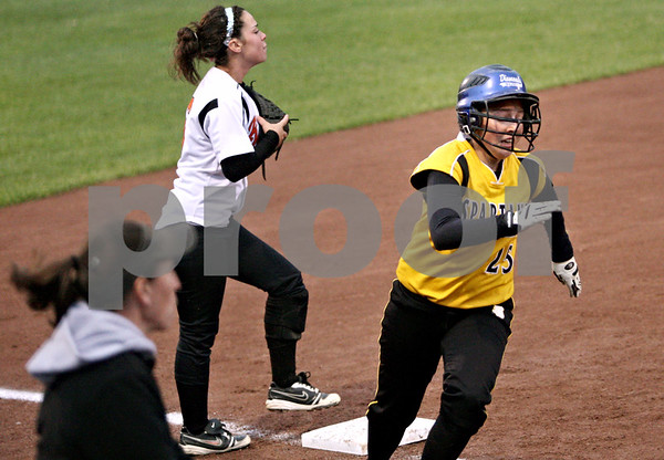 Rob Winner – rwinner@daily-chronicle.com<br /> <br /> Meranda Brashears (25) rounds third base and heads for home to score one of Sycamore's four runs during the second inning of Friday night's game against DeKalb.<br /> <br /> DeKalb, Ill.<br /> Friday May 7, 2010