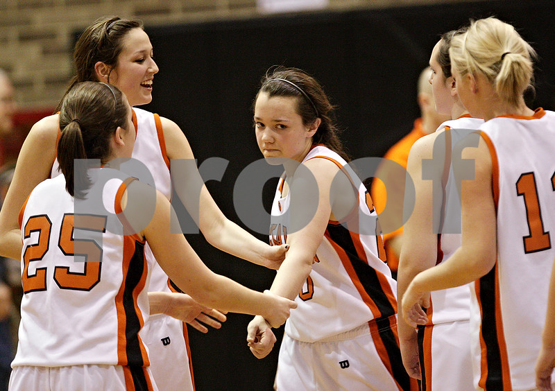 Beck Diefenbach  -  bdiefenbach@daily-chronicle.com<br /> <br /> DeKalb players console Taylor White (20, center) after she missed a last-second shot which could have tied the game against Geneva at DeKalb High School, in DeKalb, Ill., on Friday Jan. 5, 2010. Geneva defeated DeKalb 44 to 41.