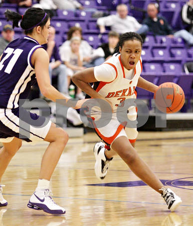 Beck Diefenbach  -  bdiefenbach@daily-chronicle.com<br /> <br /> DeKalb's Michelle Todd (3) dribbles with the ball during the second quarter of the IHSA Class 3A Regional game at Rochelle Township High School in Rochelle, Ill., on Wednesday Feb. 17, 2010