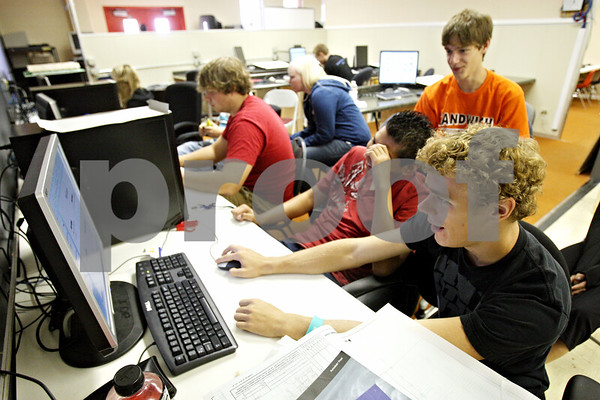 Rob Winner – rwinner@daily-chronicle.com<br /> <br /> Indian Valley Vocational Center student Zach Barrera (front) works with fellow students in the drafting and design classroom on Thursday September 16, 2010 in Sandwich, Ill.