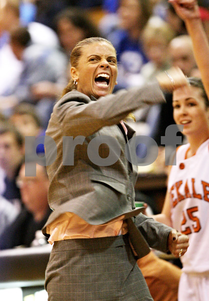 Beck Diefenbach  -  bdiefenbach@daily-chronicle.com<br /> <br /> DeKalb head coach Debbie Whitman reacts as DeKalb closes in on Geneva during the third quarter of the game at DeKalb High School, in DeKalb, Ill., on Friday Jan. 5, 2010. Geneva defeated DeKalb 44 to 41.