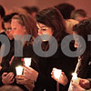 "Kyle Bursaw - kbursaw@daily-chronicle.com<br /> <br /> Several hold candles in the front row of the community gathering honoring Antinette ""Toni"" Keller Tuesday. 10.26.10"