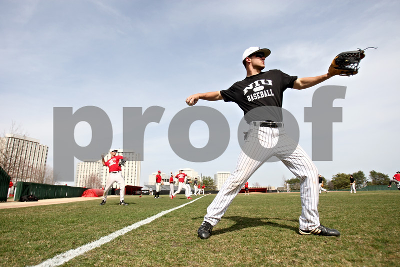 Rob Winner – rwinner@daily-chronicle.com<br /> <br /> Jamison Wells stretches out playing catch at the start of NIU baseball practice on Thursday April 1, 2010 in DeKalb, Ill.