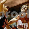 Rob Winner – rwinner@daily-chronicle.com<br /> <br /> Harlem's Alyssa Morris pressures DeKalb's Emily Bemis as Bemis looks to shoot in the second quarter on Tuesday November 16, 2010 in DeKalb, Ill.