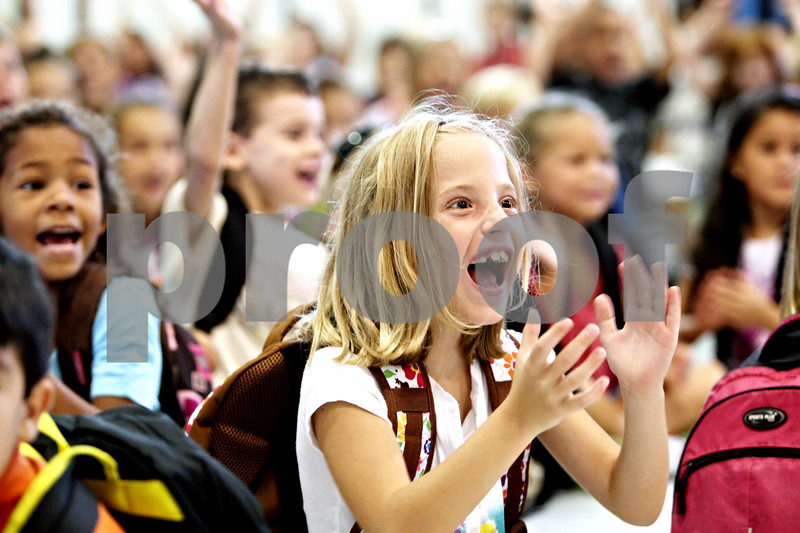 Rob Winner – rwinner@daily-chronicle.com<br /> <br /> Incoming second grade student Emma Grace, 7, cheers as Malta Elementary School principal Connie Rohlman (not pictured) introduces the teachers on the morning of Monday August 23, 2010 in Malta, Ill. This was the last first day of school for Malta Elementary School which will be closed at the end of the academic year.