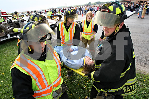 Rob Winner – rwinner@daily-chronicle.com<br /> <br /> Allison Kidd-Probst, of Shabbona, is carried away from the scene of a simulated accident by Waterman firefighters at Indian Creek High School in Shabbona, Ill. on Friday April 30, 2010.