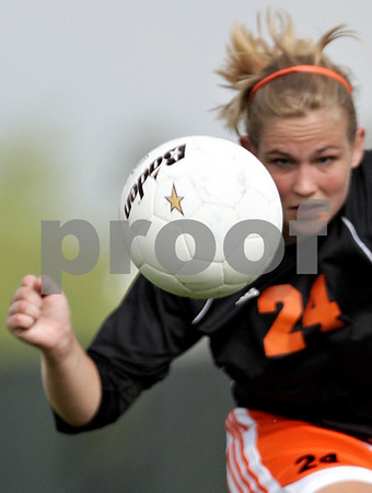 Beck Diefenbach  -  bdiefenbach@daily-chronicle.com<br /> <br /> DeKalb's Karen Lehan (24) keeps her eye on the ball during the first half of the IHSA Class 2A Rochelle Regional Championship against Sycamore at Rochelle Township High School in Rochelle, Ill., on Friday May 21, 2010. Sycamore defeated DeKalb 2 to 1.