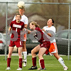 Beck Diefenbach  -  bdiefenbach@daily-chronicle.com<br /> <br /> DeKalb's Cara Sisler (4, top left) heads the ball above Plainfield North's Callie O'Donnell (1, left) during the second half of the game at DeKalb High School in DeKalb, Ill., on Monday April 12, 2010. Plainfield North defeated Dekalb 4 to 1.