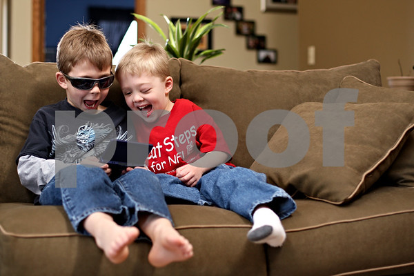 Beck Diefenbach  -  bdiefenbach@daily-chronicle.com<br /> <br /> Tyler Neppel, right, 4, plays with his brother Carter, left, 6, at their family's  Sycamore home on Friday March 5, 2010. Tyler is living with Neurofibromatosis which causes tumors to grow around his eye and his shin.