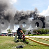 Rob Winner – rwinner@daily-chronicle.com<br /> <br /> A DeKalb Firefighter attaches a hose to hydrant near the corner of Harvestore Drive and Wagner Court while responding to a chemical fire at Right Pointe Company located at 234 Harvestore Drive in DeKalb, Ill. on Wednesday July 21, 2010.