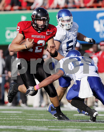 Rob Winner – rwinner@daily-chronicle.com<br /> <br /> Northern Illinois quarterback Chandler Harnish carries the ball during the second quarter in DeKalb, Ill. on Saturday October 16, 2010.