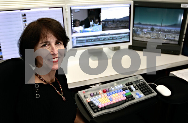 Kyle Bursaw - kbursaw@daily-chronicle.com<br /> <br /> NIU Professor Laura Vazquez co-created an hour long documentary on homeless women and children. She edited the film at this multi-screen computer set up in a lab at NIU.