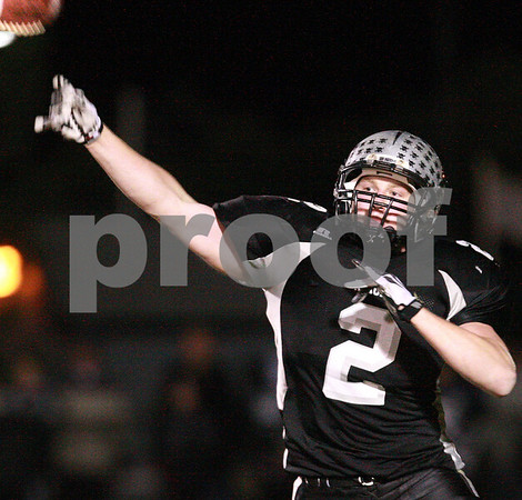 Kyle Bursaw – kbursaw@daily-chronicle.com<br /> <br /> After taking a direct snap Wide Receiver Blake Serpa completes a pass downfield in the third quarter. The Montini Broncos defeated the Kaneland Knights 27-14 at Kaneland High School on Saturday, Nov. 20, 2010 in Maple Park, Ill.