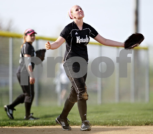 Beck Diefenbach  -  bdiefenbach@daily-chronicle.com<br /> <br /> Kaneland's McKinzie Mangers (20) reacts after she was unable to catch a foul ball during the third inning of the game at Sycamore High School in Sycamore, Ill., on Tuesday April 20, 2010. Kaneland defeated Sycamore 10 to 0 in six innings.
