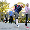 Rob Winner – rwinner@daily-chronicle.com<br /> <br /> Students and staff cross Maple Street while walking west on Washington Street on their way to school during participation in National Walk to School Day in Somonauk, Ill., on Wednesday Oct. 6, 2010.