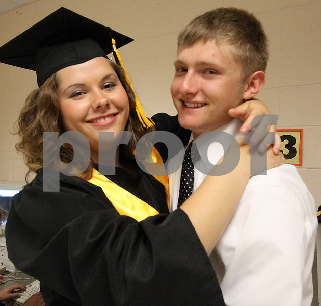 Wendy Kemp/For The Daily Chronicle<br /> Paige Myers hugs fellow graduate Zachary Wright before the graduation ceremony at Sycamore High School on Sunday.<br /> Sycamore 5/30/10