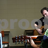 Beck Diefenbach  -  bdiefenbach@daily-chronicle.com<br /> <br /> Teacher Quentin Dover works on strumming with Nicholas Chen (far right), 8, of DeKalb, Ill., during a guitar basics lesson at the Northern Illinois University Community School of Music in DeKalb, Ill., on Wednesday March 17, 2010.