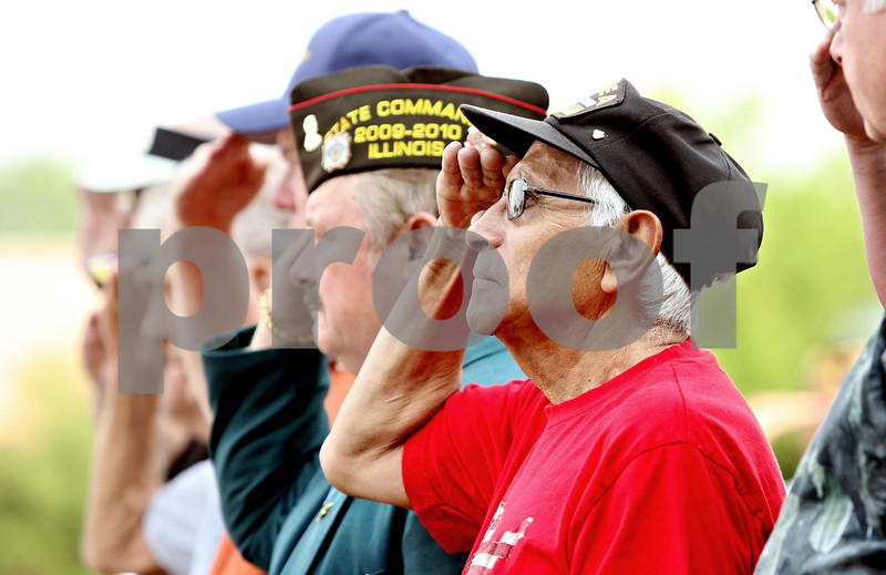 Rob Winner – rwinner@daily-chronicle.com<br /> <br /> Army veteran Eugene Wisser, of Dekalb, who served in the Korean War, salutes during a ceremony at Memorial Park on Monday May 31, 2010 in DeKalb, Ill.