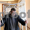 Rob Winner – rwinner@daily-chronicle.com<br /> <br /> Rodney McKiness sets up voting booths at the DeKalb County Farm Bureau in Sycamore, Ill. on Monday November 1, 2010.