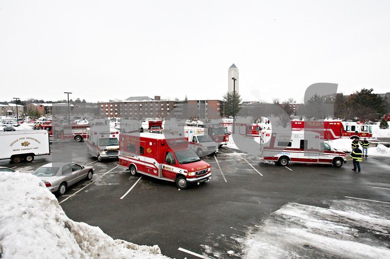 Chronicle File Photo<br /> <br /> Emergency personnel vehicles collect in the parking lots surronding Cole Hall on February 14, 2008 at NIU in DeKalb, Ill.