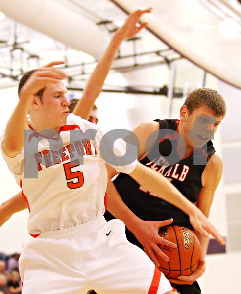 Beck Diefenbach – bdiefenbach@daily-chronicle.com<br /> <br /> DeKalb's Jordan Threloff (42, right) rebounds the ball around Freeport's Luke Norman (5) during the fourth quarter of the IHSA Class 3A semifinal game at Hampshire High School in Hampshire, Ill., on Wednesday March 10, 2010.