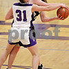 Beck Diefenbach  -  bdiefenbach@daily-chronicle.com<br /> <br /> Sycamore's Jessica Pluhm (30) can't find an open pass around Hampshire's Alex Dumoulin (31) during the fourth quarter of the IHSA Class 3A Regional game at Rochelle Township High School in Rochelle, Ill., on Wednesday Feb. 17, 2010
