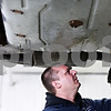 Beck Diefenbach  -  bdiefenbach@daily-chronicle.com<br /> <br /> Mechanic Norm Parker works on a car's break system during Bockman's Auto Care's first day in their new location at 2158 Oakland Dr. in Sycamore on Monday March 29, 2010.
