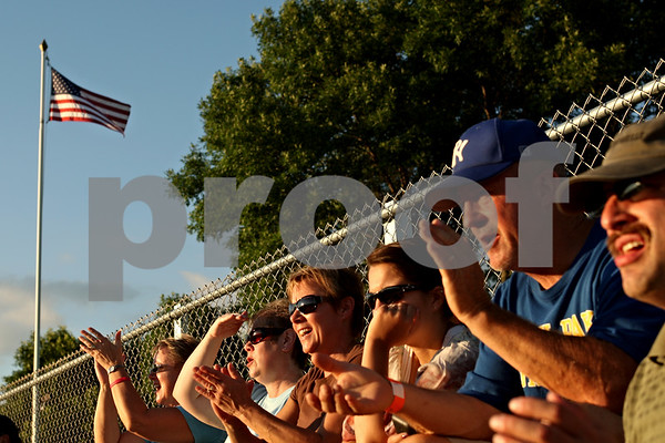 Beck Diefenbach  -  bdiefenbach@daily-chronicle.com<br /> <br /> Fans cheer on the Liners during the  DeKalb County Liners home opening game at Founder Field at Sycamore Park in Sycamore, Ill., on Wednesday June 16, 2010.