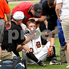 Beck Diefenbach  -  bdiefenbach@daily-chronicle.com<br /> <br /> DeKalb's Jake Gordon is tended to during the first inning of the IHSA Class 3A State Semifinal Game against Marian Central in Joliet, Ill., on Friday June 11, 2010.