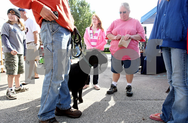 Rob Winner – rwinner@daily-chronicle.com<br /> <br /> Genoa resident Travis Hughes, 15, walks Sam, a miniature pygmy goat, around the open air market during the Harvest Moon Festival in Genoa, Ill. on Saturday September 25, 2010.