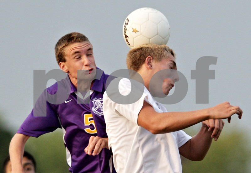 Beck Diefenbach - bdiefenbach@daily-chronicle.com<br /> <br /> Hononegah Jacob Harp (5, left) and DeKalb's Dylan Vaughn-Low (12) jump to head the ball during the second half of the game at DeKalb High School in DeKalb, Ill., on Tuesday Aug. 24, 2010. DeKalb and Hononegah tied 1 to 1.
