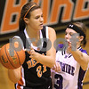 Kyle Bursaw – kbursaw@daily-chronicle.com<br /> <br /> DeKalb's Kelli Gerace passes against the defense of Grace Jakubowski in the first quarter. Hampshire defeated DeKalb 46-38 at DeKalb High School on Saturday, Nov. 27, 2010 during the Turkey Toss-Up tournament.
