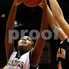 Rob Winner – rwinner@daily-chronicle.com<br /> Sycamore's Montia Johnson grabs a rebound in the first half during the Castle Challenge on Friday January 29, 2010 in DeKalb, Ill.